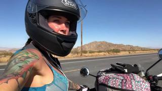 felicity feline riding on aprilia tuono motorcycle